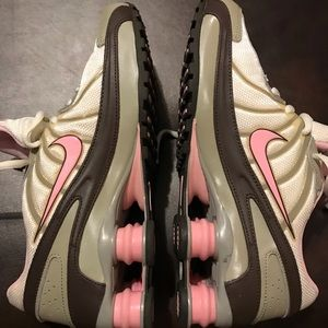 Nike shox pink, white and purplish colors.